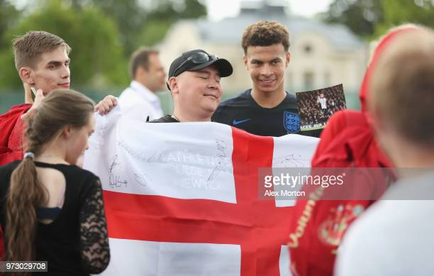 Dele Alli of England poses for a photo with fans during a training session as part of the England media access at Spartak Zelenogorsk Stadium ahead...