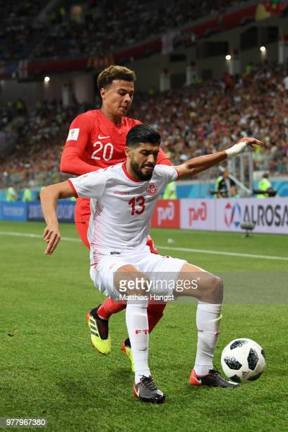 Dele Alli of England puts pressure on Ferjani Sassi of Tunisia during the 2018 FIFA World Cup Russia group G match between Tunisia and England at...