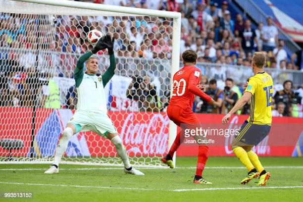 Dele Alli of England scores the second goal beating goalkeeper of Sweden Robin Olsen the 2018 FIFA World Cup Russia Quarter Final match between...