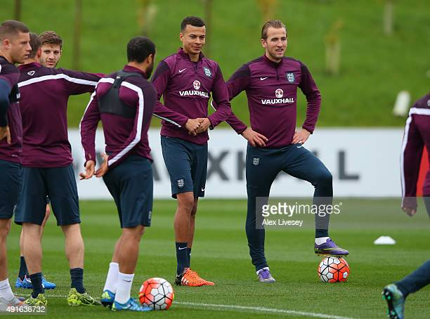 Dele Alli of England talks with his club mate Harry Kane during the England training session at St Georges Park on October 7 2015 in BurtonuponTrent...