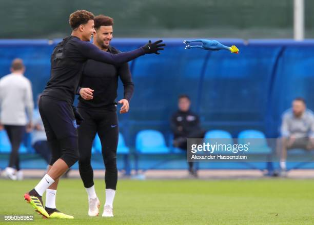 Dele Alli of England throws a toy chicken while Kyle Walker of England looks on during the England training session on July 10 2018 in Saint...