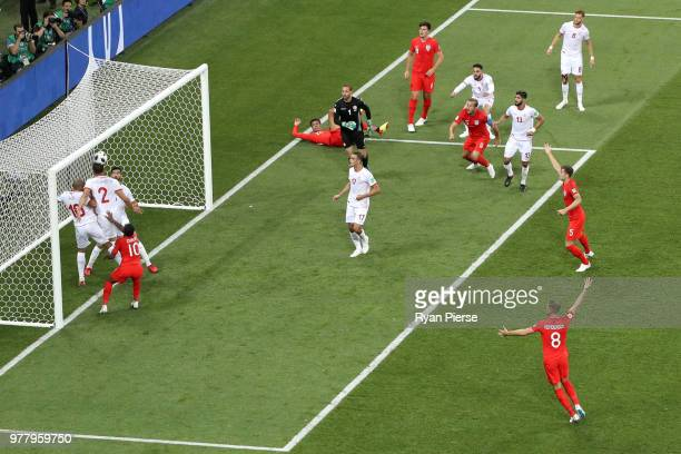 Dele Alli of England's shot hits on bar and is cleard by Syam Ben Youssef and Wahbi Khazri of Tunisia during the 2018 FIFA World Cup Russia group G...