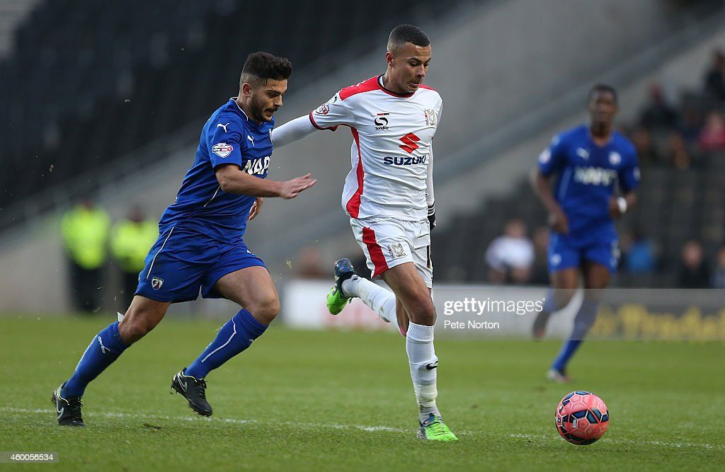 Dele Alli of MK Dons looks to the ball with Sam Morsy of Chesterfield during the FA Cup Second Round match between MK Dons and Chesterfield at Stadium mk on December 6, 2014 in Milton Keynes, England.