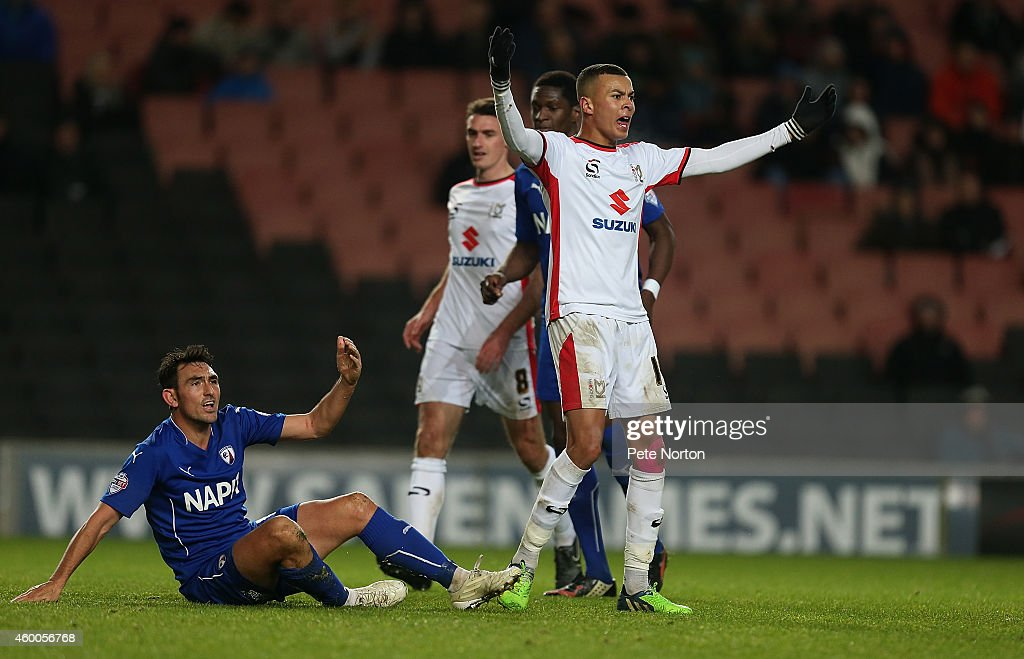 Dele Alli of MK Dons remonstrates after committing a foul on Gary Roberts (l) of Chesterfield during the FA Cup Second Round match between MK Dons and Chesterfield at Stadium mk on December 6, 2014 in Milton Keynes, England.