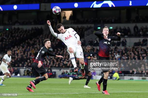 Dele Alli of Spurs battles with Marcel Halstenberg of RB Leipzig during the UEFA Champions League round of 16 first leg match between Tottenham...