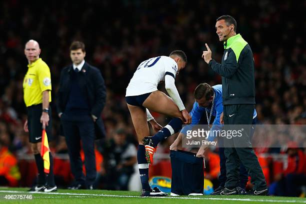 Dele Alli of Spurs changes his shorts during the Barclays Premier League match between Arsenal and Tottenham Hotspur at the Emirates Stadium on...