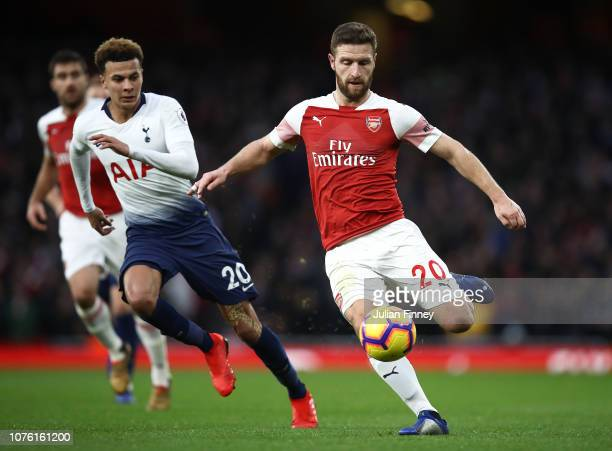 Dele Alli of Spurs chases Shkodran Mustafi of Arsenal during the Premier League match between Arsenal FC and Tottenham Hotspur at Emirates Stadium on...