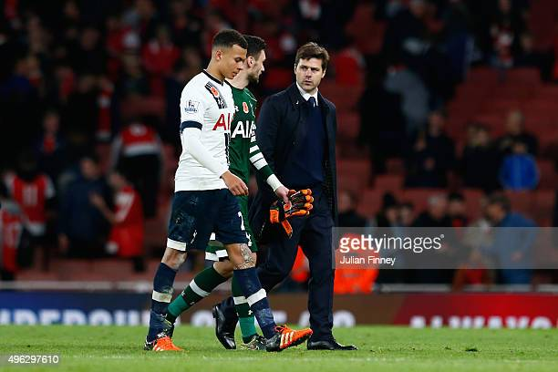 Dele Alli of Spurs Hugo Lloris of Spurs and Mauricio Pochettino Manager of Spurs leave the field following the Barclays Premier League match between...