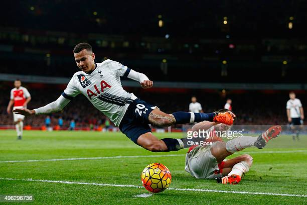 Dele Alli of Spurs is tackled by Mathieu Debuchy of Arsenal during the Barclays Premier League match between Arsenal and Tottenham Hotspur at the...