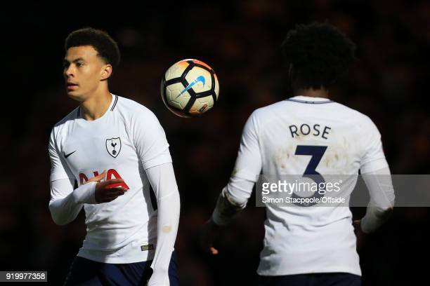 Dele Alli of Spurs throws the ball to teammate Danny Rose of Spurs during The Emirates FA Cup Fifth Round match between Rochdale AFC and Tottenham...