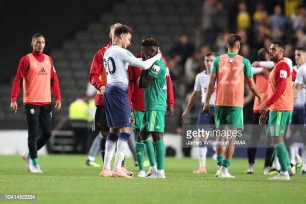 Dele Alli of Tottenham and Domingos Quina of Watford during the Carabao Cup Third Round match between Tottenham Hotspur and Watford at Stadium mk on...