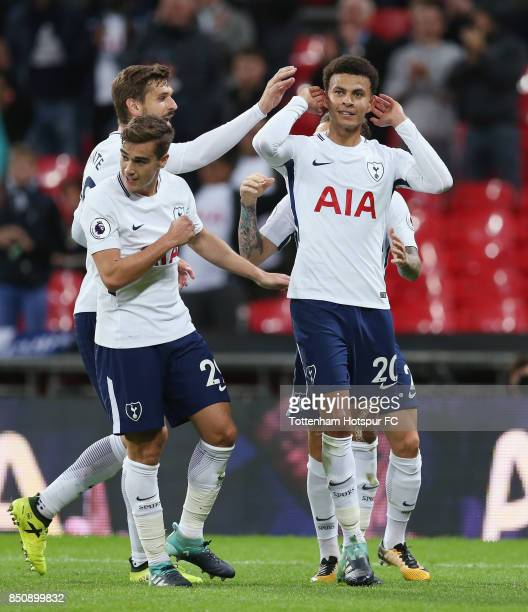 Dele Alli of Tottenham celebrates after scoring their first goal during the Carabao Cup Third Round match between Tottenham Hotspur and Barnsley at...