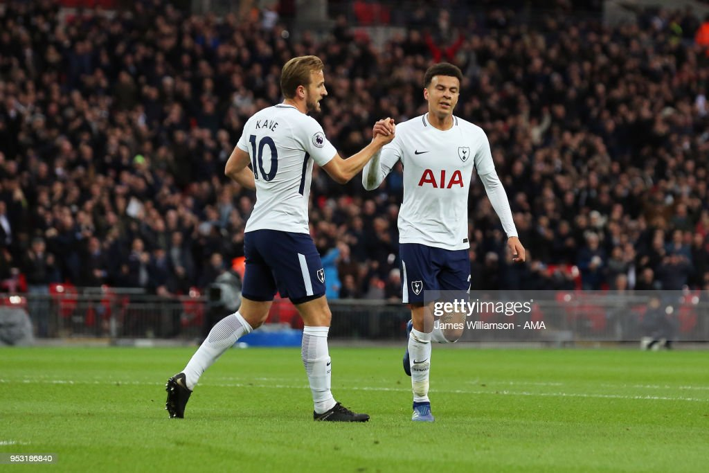 Dele Alli of Tottenham celebrates with Harry Kane of Tottenham after scoring a goal to make it 1-0 during the Premier League match between Tottenham Hotspur and Watford at Wembley Stadium on April 30, 2018 in London, England.