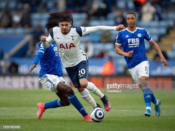 Dele Alli of Tottenham Hotpsur in action with Wilfred Ndidi and Youri Tielemans of Leicester City in action during the Premier League match between...
