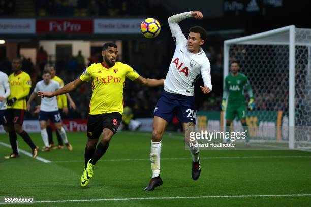 Dele Alli of Tottenham Hotspur and Adrian Mariappa of Watford in action during the Premier League match between Watford and Tottenham Hotspur at...