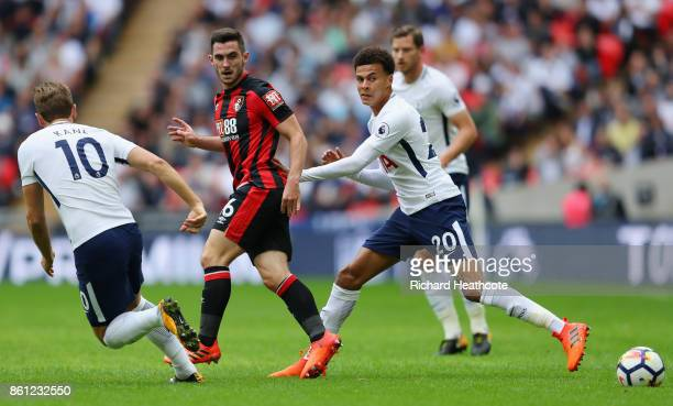 Dele Alli of Tottenham Hotspur and Andrew Surman of AFC Bournemouth in action during the Premier League match between Tottenham Hotspur and AFC...