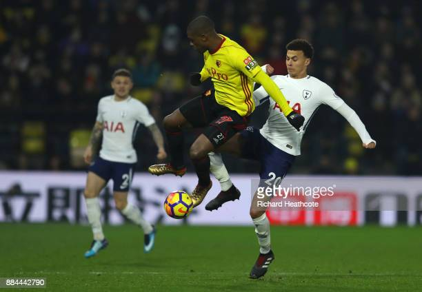 Dele Alli of Tottenham Hotspur and Christian Kabasele of Watford during the Premier League match between Watford and Tottenham Hotspur at Vicarage...