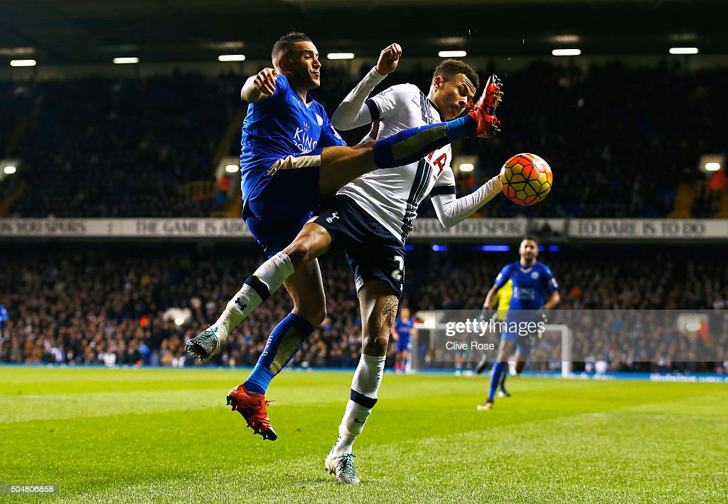 Dele Alli of Tottenham Hotspur and Danny Simpson of Leicester City compete for the ball during the Barclays Premier League match between Tottenham Hotspur and Leicester City at White Hart Lane on January 13, 2016 in London, England.