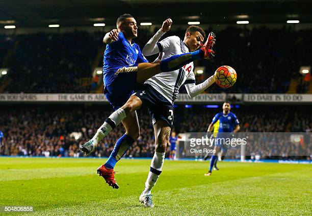 Dele Alli of Tottenham Hotspur and Danny Simpson of Leicester City compete for the ball during the Barclays Premier League match between Tottenham...