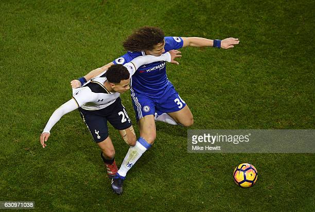 Dele Alli of Tottenham Hotspur and David Luiz of Chelsea battle for possession during the Premier League match between Tottenham Hotspur and Chelsea...