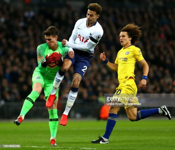 Dele Alli of Tottenham Hotspur and David Luizand Kepa Arrizabalaga of Chelsea FC in action during the Premier League match between Tottenham Hotspur...
