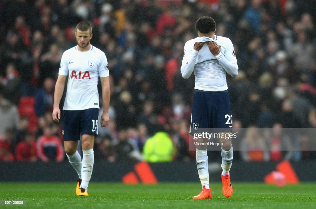 Dele Alli of Tottenham Hotspur and Eric Dier of Tottenham Hotspur are dejeted after the Premier League match between Manchester United and Tottenham Hotspur at Old Trafford on October 28, 2017 in Manchester, England.