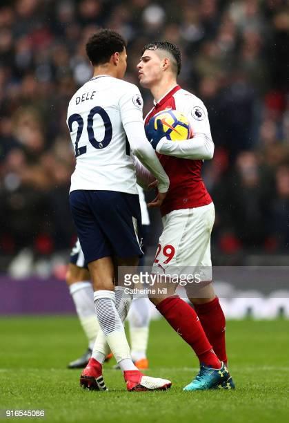 Dele Alli of Tottenham Hotspur and Granit Xhaka of Arsenal speak during the Premier League match between Tottenham Hotspur and Arsenal at Wembley...