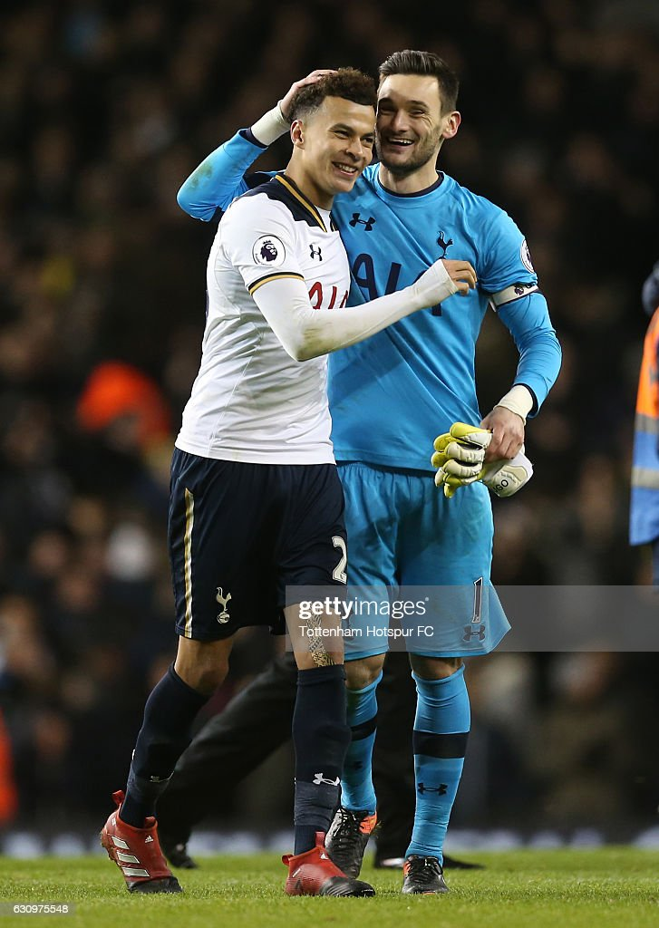 Dele Alli of Tottenham Hotspur (L) and Hugo Lloris of Tottenham Hotspur (R) celebrate together after the Premier League match between Tottenham Hotspur and Chelsea at White Hart Lane on January 4, 2017 in London, England.