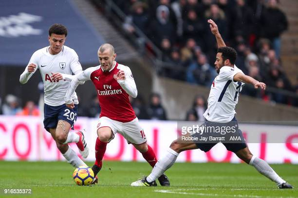 Dele Alli of Tottenham Hotspur and Jack Wilshere of Arsenal and Mousa Dembele of Tottenham Hotspur during the Premier League match between Tottenham...