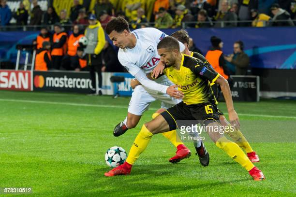 Dele Alli of Tottenham Hotspur and Jeremy Toljan of Borussia Dortmund battle for the ball during the UEFA Champions League group H match between...