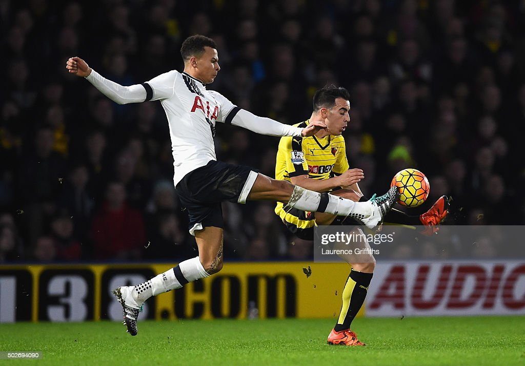 Dele Alli of Tottenham Hotspur and Jose Manuel Jurado of Watford compete for the ball during the Barclays Premier League match between Watford and Tottenham Hotspur at Vicarage Road on December 28, 2015 in Watford, England.
