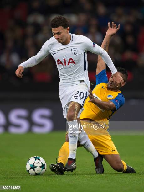Dele Alli of Tottenham Hotspur and Lorenzo Ebecilio of Apoel Nikosia in action during the UEFA Champions League group H match between Tottenham...