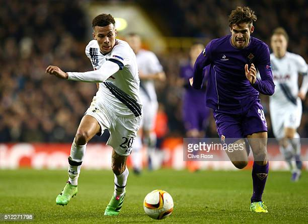 Dele Alli of Tottenham Hotspur and Marcos Alonso of Fiorentina compete for the ball during the UEFA Europa League round of 32 second leg match...