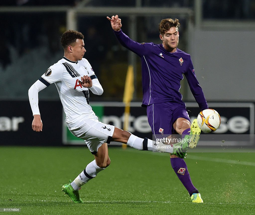 Dele Alli of Tottenham Hotspur and Marcos Alonso of Fiorentina in action during the UEFA Europa League Round of 32 first leg match between Fiorentina and Tottenham Hotspur at Stadio Artemio Franchi on February 18, 2016 in Florence, Italy.