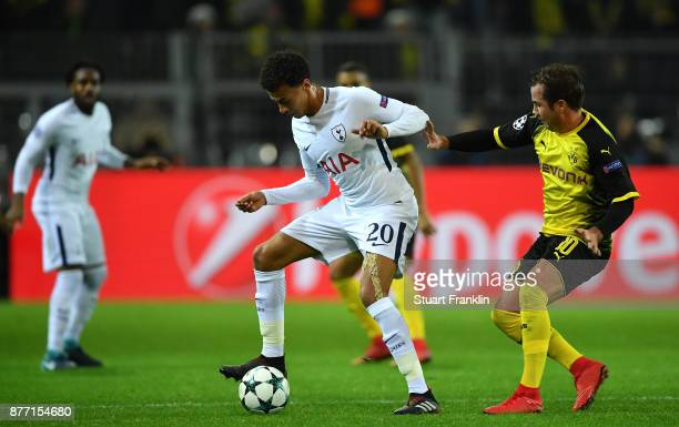 Dele Alli of Tottenham Hotspur and Mario Gotze of Borussia Dortmund in action during the UEFA Champions League group H match between Borussia...