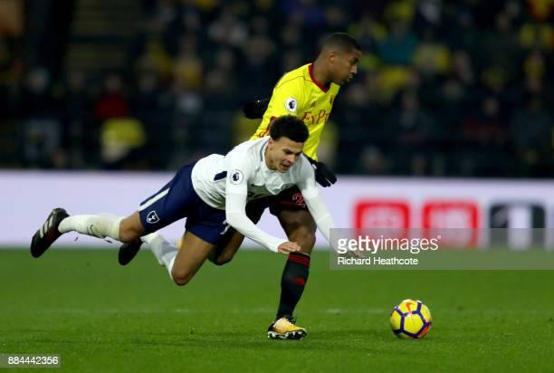 Dele Alli of Tottenham Hotspur and Marvin Zeegelaar of Watford in action during the Premier League match between Watford and Tottenham Hotspur at...