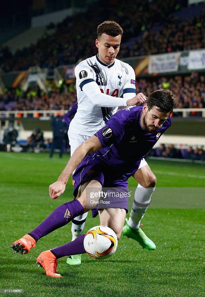 Dele Alli of Tottenham Hotspur and Nenad Tomovic of Fiorentina compete for the ball during the UEFA Europa League round of 32 first leg match between Fiorentina and Tottenham Hotspur at Stadio Artemio Franchi on February 18, 2016 in Florence, Italy.