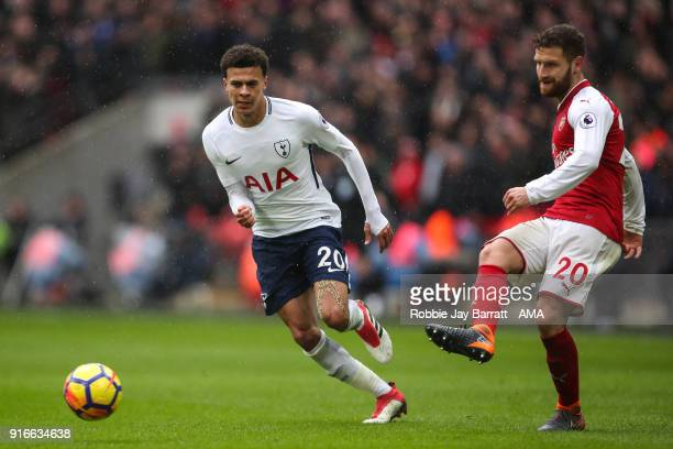 Dele Alli of Tottenham Hotspur and Shkodran Mustafi of Arsenal during the Premier League match between Tottenham Hotspur and Arsenal at Wembley...