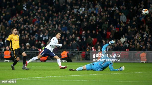 Dele Alli of Tottenham Hotspur attempts to lob Joe Day of Newport County during The Emirates FA Cup Fourth Round Replay match between Tottenham...