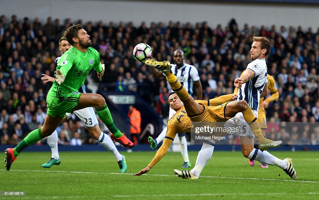 Dele Alli of Tottenham Hotspur (R) attempts to score past Ben Foster of West Bromwich Albion (L) but shot goes wide during the Premier League match between West Bromwich Albion and Tottenham Hotspur at The Hawthorns on October 15, 2016 in West Bromwich, England.