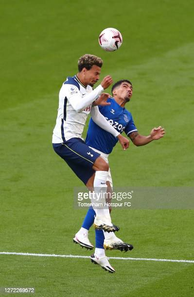 Dele Alli of Tottenham Hotspur battles for possession with Allan of Everton during the Premier League match between Tottenham Hotspur and Everton at...