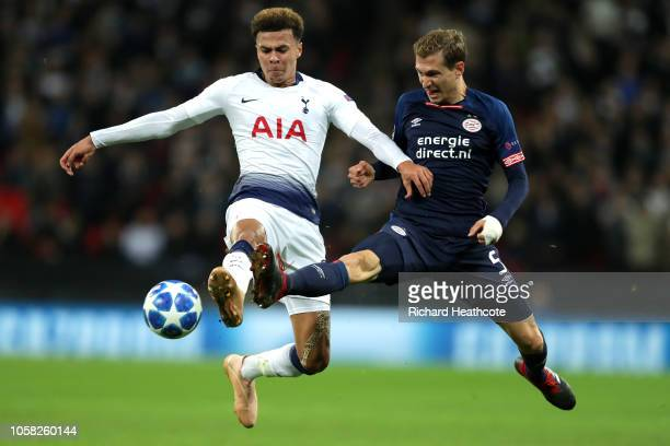 Dele Alli of Tottenham Hotspur battles for possession with Daniel Schwaab of PSV Eindhoven during the Group B match of the UEFA Champions League...