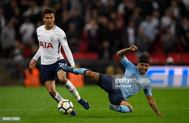 Dele Alli of Tottenham Hotspur battles for possession with Deandre Yedlin of Newcastle United during the Premier League match between Tottenham...
