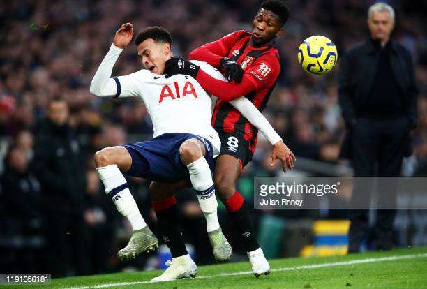 Dele Alli of Tottenham Hotspur battles for possession with Jefferson Lerma of AFC Bournemouth during the Premier League match between Tottenham...