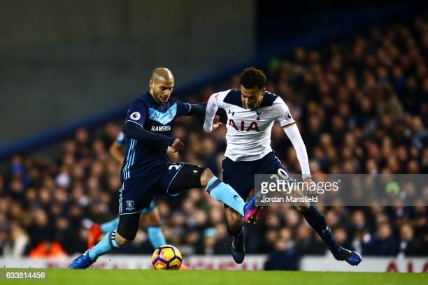 Dele Alli of Tottenham Hotspur battles for the ball with Adlene Guedioura of Middlesbrough during the Premier League match between Tottenham Hotspur...