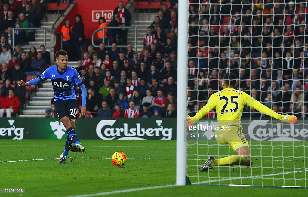 Dele Alli of Tottenham Hotspur (20) beats goalkeeper Paulo Gazzaniga of Southampton to score their second goal during the Barclays Premier League match between Southampton and Tottenham Hotspur at St Mary's Stadium on December 19, 2015 in Southampton, England.