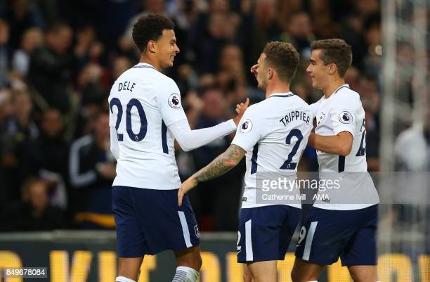 Dele Alli of Tottenham Hotspur celebrates after he scores a goal to make it 10 with Kieran Trippier and Harry Winks of Tottenham Hotspur during the...