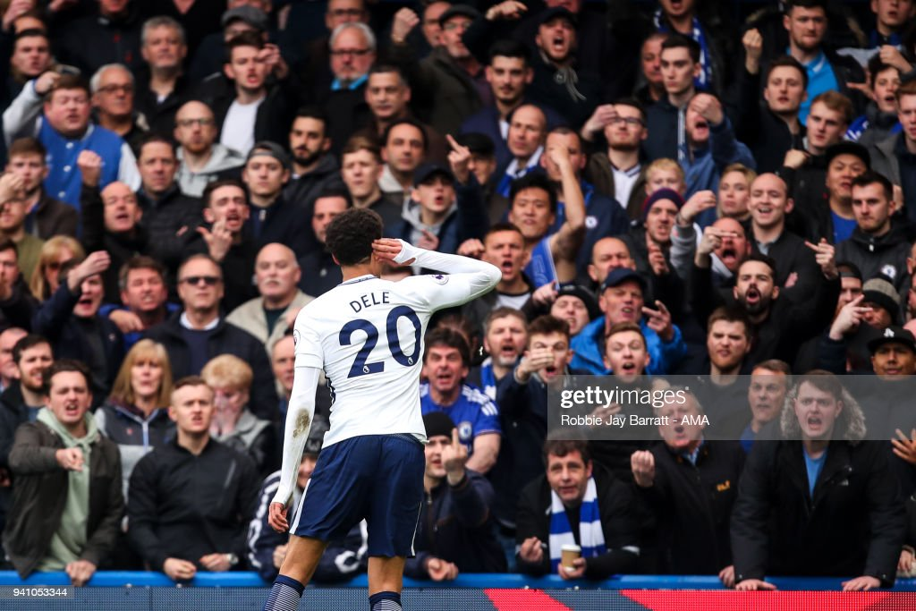 Dele Alli of Tottenham Hotspur celebrates after scoring a goal to make it 1-2 during the Premier League match between Chelsea and Tottenham Hotspur at Stamford Bridge on April 1, 2018 in London, England.