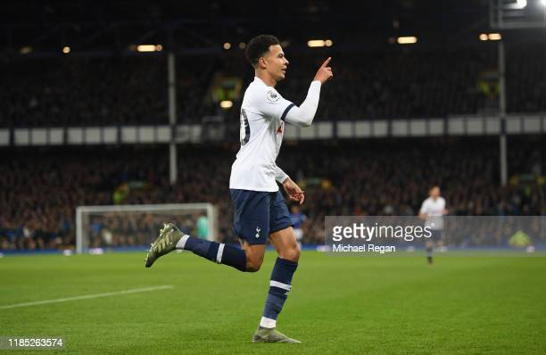 Dele Alli of Tottenham Hotspur celebrates after scoring his sides first goal during the Premier League match between Everton FC and Tottenham Hotspur...