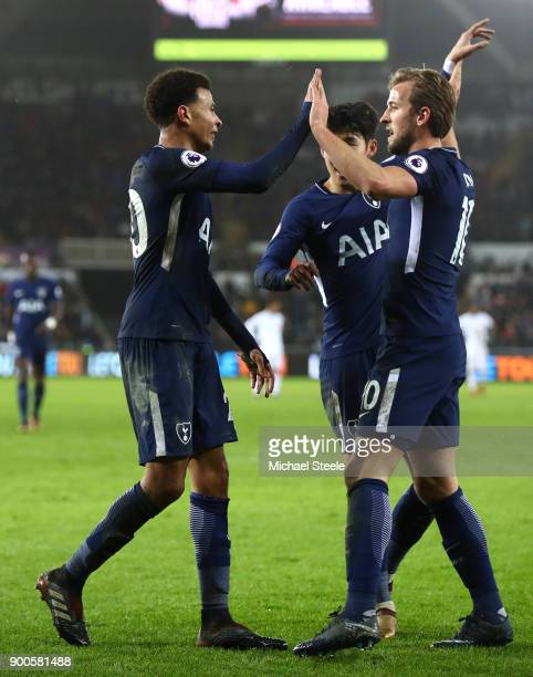 Dele Alli of Tottenham Hotspur celebrates after scoring his sides second goal with HeungMin Son of Tottenham Hotspur and Harry Kane of Tottenham...